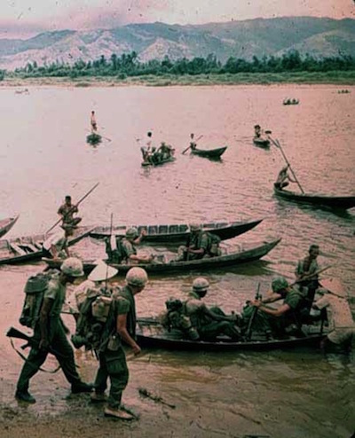 Marines crossing a river in small boats